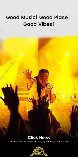A Rock Singer At a Musical Concert Hosted In a Grand Banquet Hall With The Beautiful Yellow and Radiant Backlights