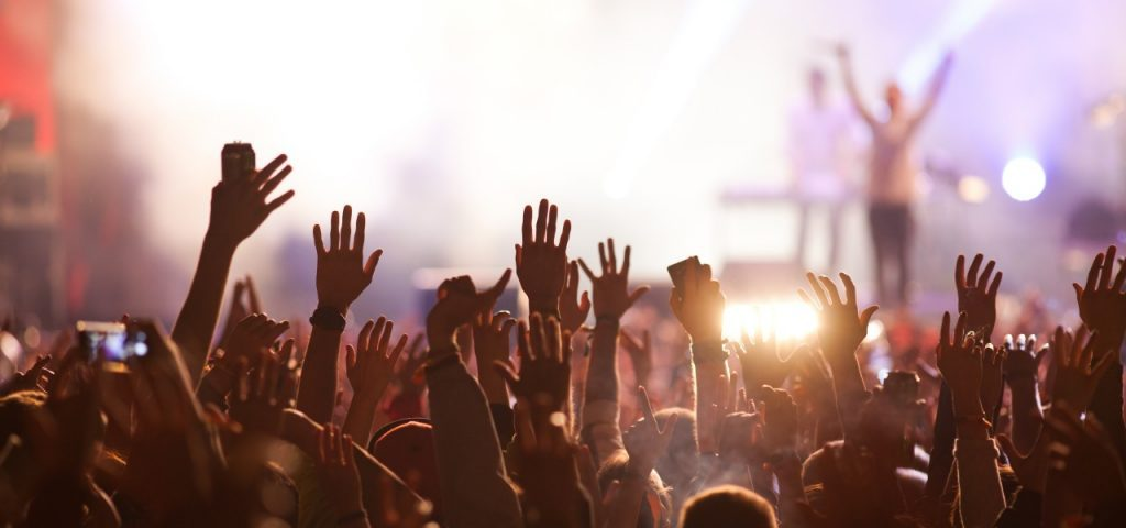 Image of a crowd surfing in the musical concert.