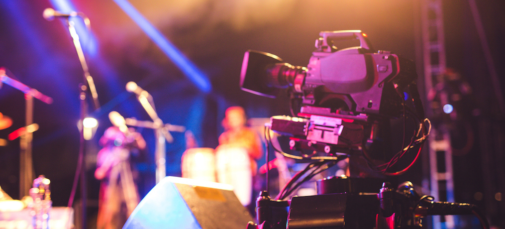 A Selective focus of Video Camera in a blur backstage background.